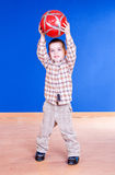 A lovely kid is playing with ball Royalty Free Stock Image