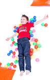A lovely kid is playing with balls Royalty Free Stock Images