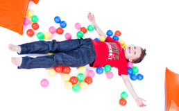 A lovely kid is playing with balls Stock Photos