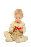 Lovely kid playing with rattle on floor Stock Image