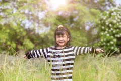 Lovely kid smiling face with happiness emotion in natural green Royalty Free Stock Photos