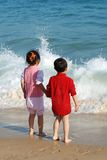 Lovely Kids. Lovely Young Kids Playing in the surfy beach Royalty Free Stock Image