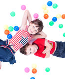 A lovely kids are playing with balls. Studio shot stock images