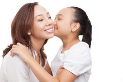 Lovely kiss. Lovely daughter giving her mom a kiss stock photo