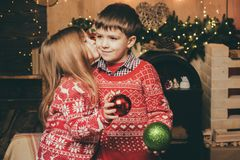 Lovely kiss. Cute little girl and boy play ornaments balls christmas tree. Kid enjoy winter holiday at home. Cozy. Christmas atmosphere. Girl baby christmas eve royalty free stock images