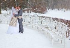 Lovely kissing in winter season Stock Images
