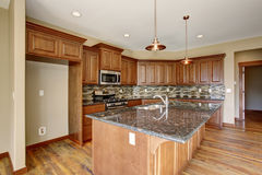 Lovely kitchen with hardwood floor and bar island. Royalty Free Stock Image