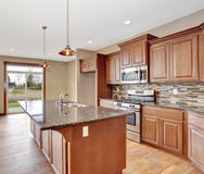 Lovely kitchen with hardwood floor and bar island. Stock Image