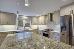 Lovely kitchen room with kitchen island royalty free stock image