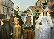 Lovely ladies in costumes for Venice Carnival. Venice, Italy - 27 February, 2009: brightly made-up women wearing costumes and masks during most significant Stock Photography