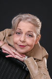 Lovely Lady. Mature Lady in leather jacket looking up Royalty Free Stock Photography