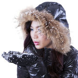Lovely lady blowing snow on palms Royalty Free Stock Image