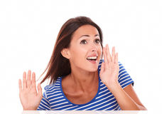 Lovely lady in blue t-shirt screaming Stock Photography