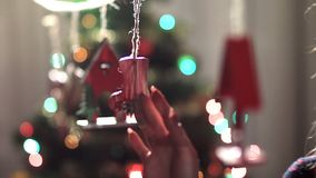 Lovely lady gently touching christmas garland stock footage