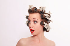 Lovely Lady with Hair Curlers Looking Surprised Stock Image