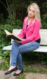 Lovely Lady Reading Outdoors Royalty Free Stock Photography