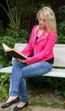 Lovely Lady Reading Outdoors Stock Photography