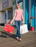 Lovely lady Shopper. A beautiful lady shopper walking by shops royalty free stock photography