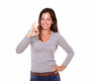 Lovely lady showing good job sign with fingers Royalty Free Stock Image