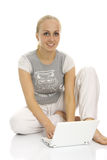 Lovely lady sitting near laptop. Royalty Free Stock Images