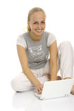 Lovely lady sitting near laptop. Royalty Free Stock Photos