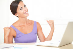 Lovely lady surfing the web and celebrating Royalty Free Stock Photography