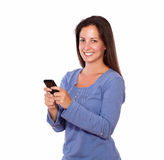 Lovely lady texting on cellphone while smiling Stock Image
