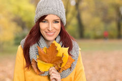Lovely lady with yellow leaves Stock Photos