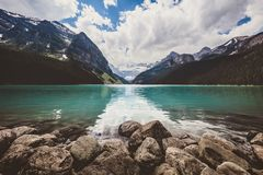 Lake Louise in the Canadian Rockies. The beautiful blue glacier fed Lake Louise on a warm summer day in Banff National Park, Canada royalty free stock images