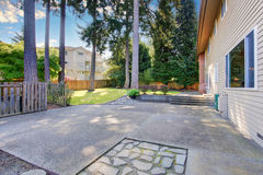 Lovely and large back yard of home with patio. Stock Images