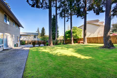 Lovely and large back yard of home with patio. Royalty Free Stock Images