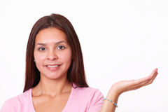 Lovely latin girl holding up her left palm Royalty Free Stock Photos
