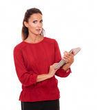Lovely latin woman working on her tablet pc royalty free stock photo
