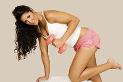 Lovely latina in gym workout. Sexy cute latina working out with free weights in gym Stock Photography
