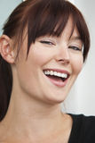 Lovely Laugh. A beautiful young brunette woman with green eyes and an lovely laugh Royalty Free Stock Image