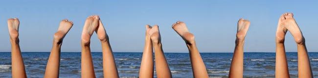 Lovely legs on the beach 5 set Stock Photo