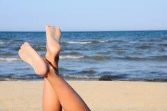 Lovely legs on the beach on sky Stock Photo