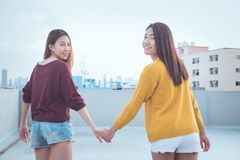 Lesbian couple together concept. Couple of young asian women wal Stock Image
