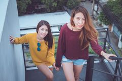 Lesbian couple together concept. Couple of young asian women wal Royalty Free Stock Images
