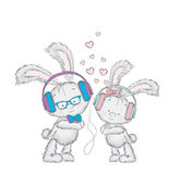 Lovely leverets headphones. Couples in love. Postcard with rabbits. Stock Photos