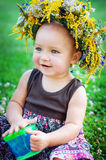 Lovely little baby girl with daisy wreath Stock Photo