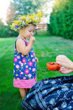 Lovely little baby girl with daisy wreath Stock Images