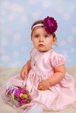 Lovely little baby girl with flower Stock Photography