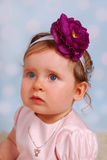 Lovely little baby girl with flower Stock Photo