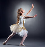Lovely little ballerina dancing at camera Royalty Free Stock Image