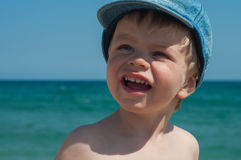 Lovely little boy in denim cap Stock Photography