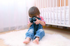 Lovely little boy with digital camera Royalty Free Stock Photos