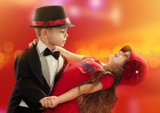 Lovely little boy and girl dancing. In lights of the city. Love concept Stock Image