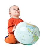 Lovely little boy with globe Stock Images