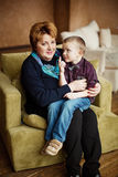 Lovely little boy with his grandmother Stock Images